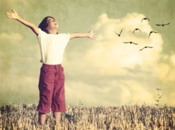 Colorized kid breathing fresh air with birds flock flying in bac