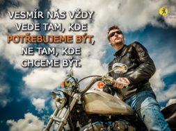 Biker man wearing a leather jacket and sunglasses sitting on his