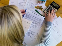 bigstock-a-woman-with-unpaid-bills-has-51927352
