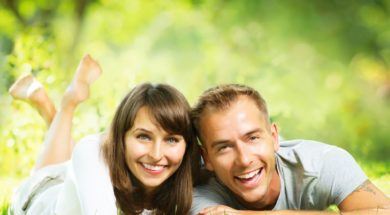 Happy Smiling Couple Together Relaxing on Green Grass. Park. You