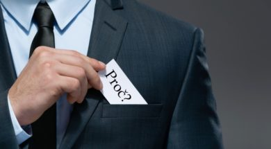 Part of body of business man who takes out business card from th