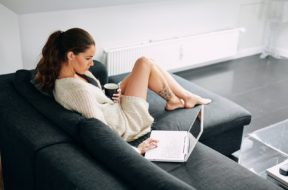 Young Woman Checking Her Emails In Morning